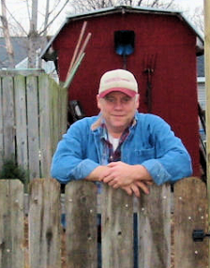 Steve the industrial copywriter leaning on the gate
