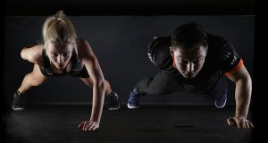 two people doing pushup, get content marketing fit