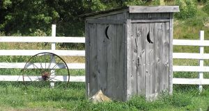 Outhouse on a farm representing cheap copywriting