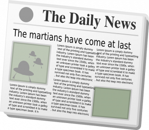 Image of newspaper. Important news shows above the fold.